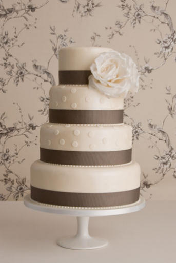This Beautiful and Chic 4 tier Wedding Cake is made of White Vanilla Fondant